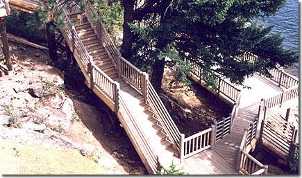 wood handrails and stairs finished deck by water project
