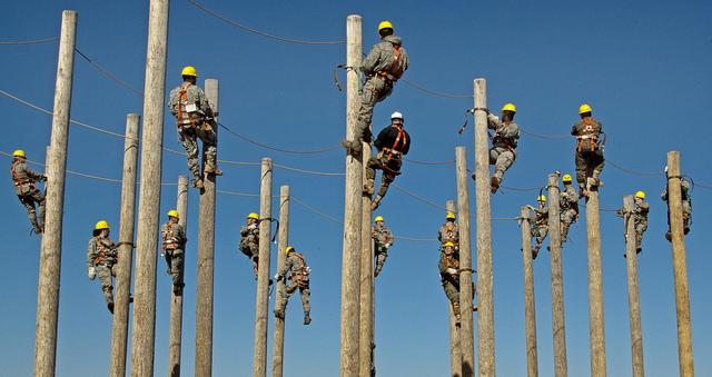 line men on class 5 utility poles