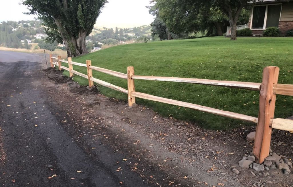 Finished sprit rail fence by North Idaho Post & Pole