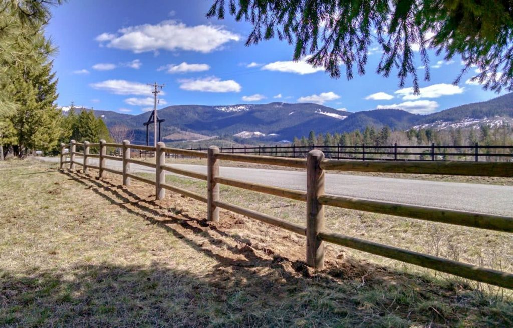 Finished pole fence by North Idaho Post & Pole