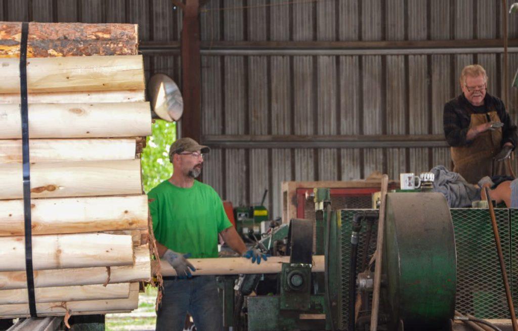 Moving log around the shop at North Idaho Post & Pole