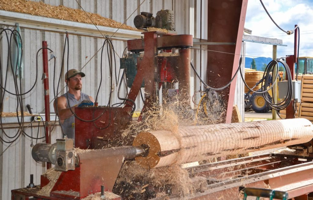 North Idaho Post and Pole turning a log on our lathe