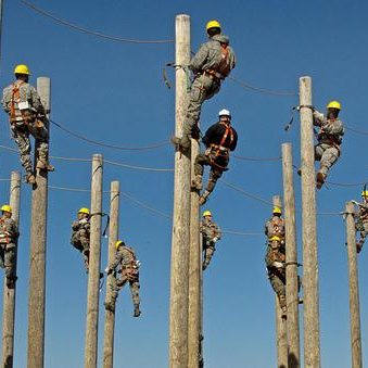 line men on class 5 utility poles